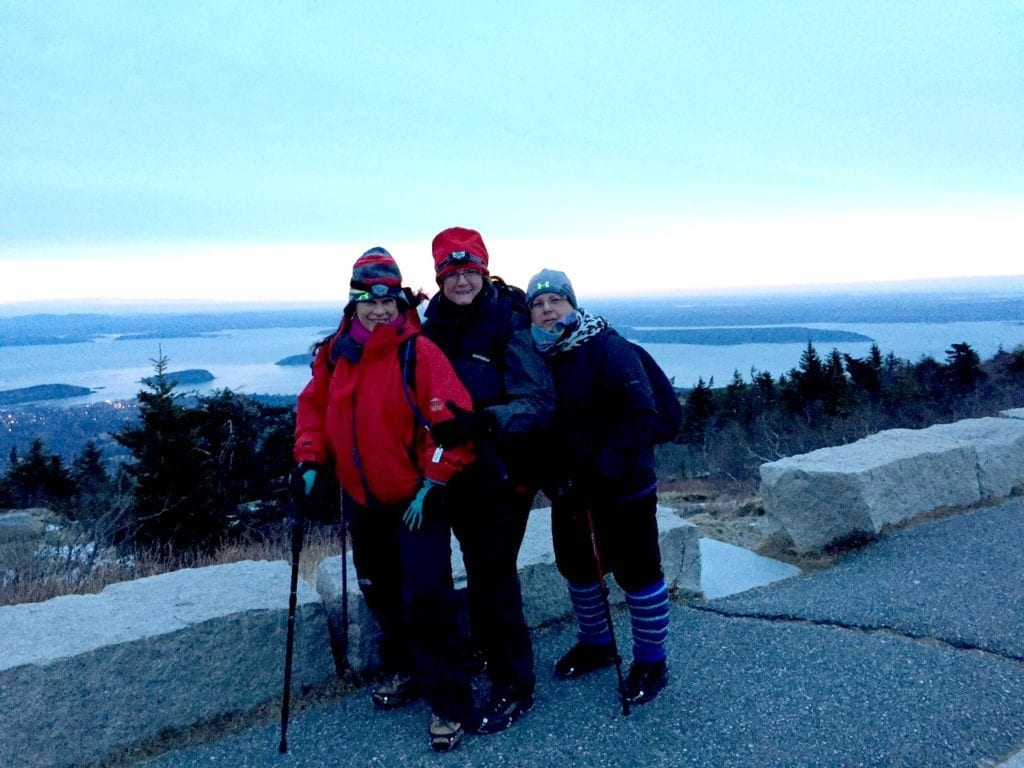 Friends Fran Capo (left), Alli Berman and Gail Jacobs pose at Cadillac Mountain on their adventure of a lifetime. Photo courtesy of Fran Capo/ Adventure TravelingMom