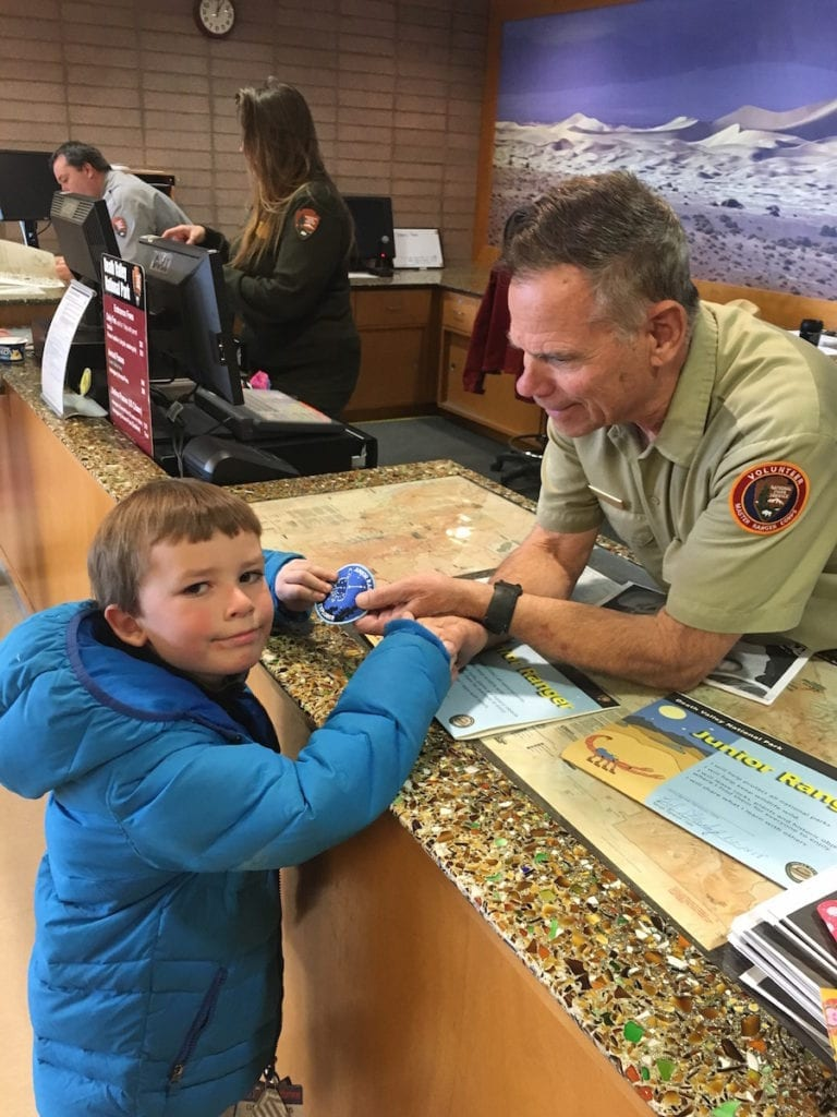 My youngest Junior Ranger just earned his Night Explorer patch in Death Valley National Park in California, an International Dark Sky Park. Photo by Catherine Parker, National Parks TravelingMom