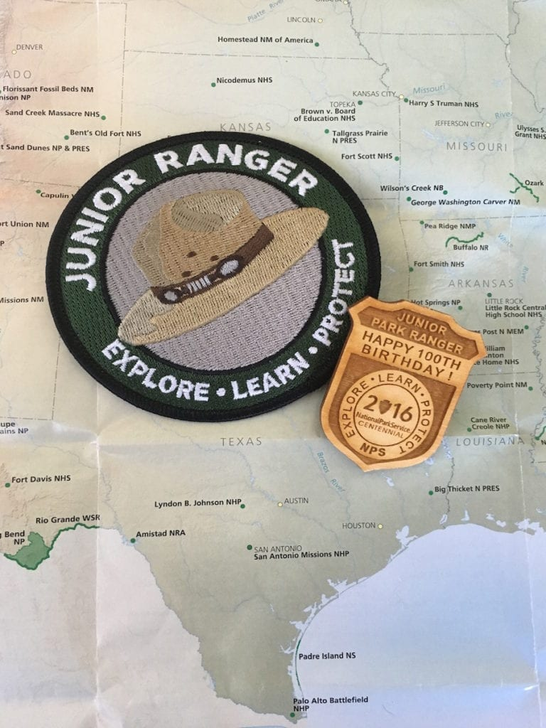 The NPS has created special commemorative Junior Ranger badges to celebrate their centennial. Photo by Catherine Parker, National Parks TravelingMom