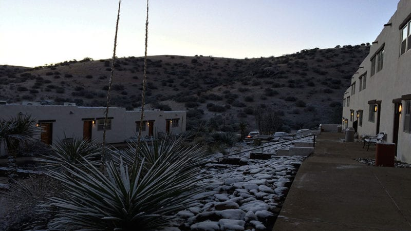 A light dusting of snow at the Indian Lodge glistens in the first light of a Texas morning.