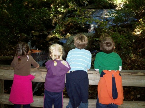 4 kids looking at a beautiful Georgia waterfall