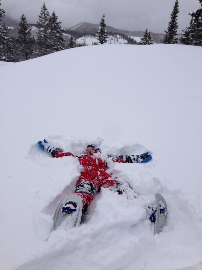 Reasons Your Family Will Love Snowshoeing snow angel