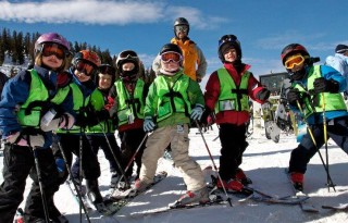 Kids love hanging out with other kids, another reason to enroll your kid in ski lessons. Pictured here: Kids at Ski School, photo courtesy of Arapahoe Basin