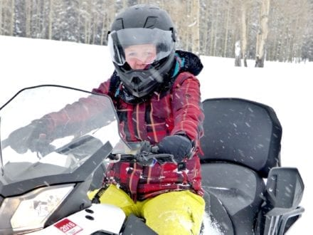 Kerry, getting the hang of it and realizing that snowmobiling really is super FUN! Photo Credit: Susie Kellogg, Unstoppable Traveling Mom