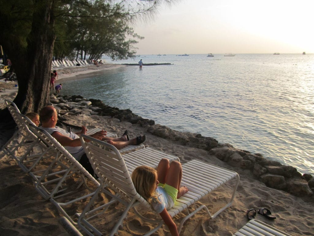 Photo by Jamie Bartosch/Suburban TravelingMom Watching the sunset on Grand Cayman Island.