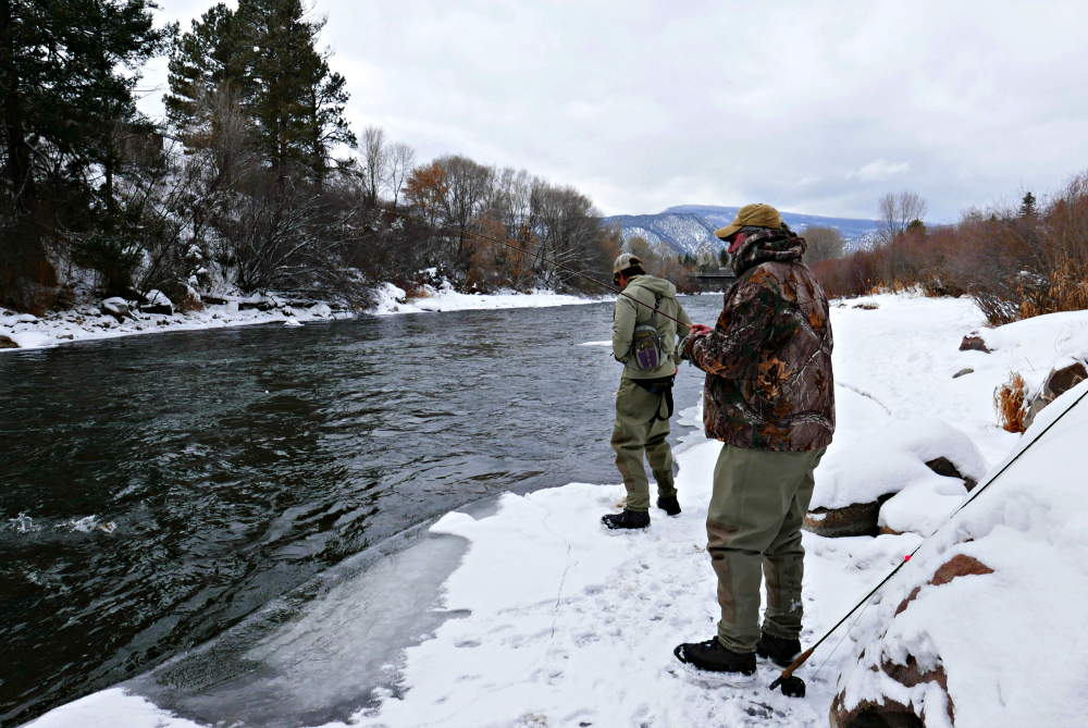 Baby it's cold out there, but fly fishing in the winter is fun for the entire family. Photo: Diana Rowe / Traveling Grandmom
