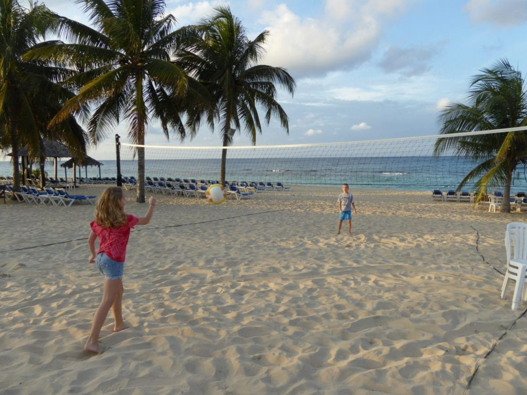 Photo by Jamie Bartosch/Suburban TravelingMom Playing beach volleyball at Jewel Runaway Bay Resort in Jamaica.
