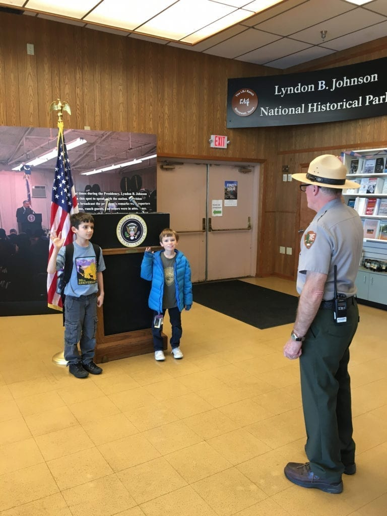 Taking the Junior Ranger Oath in front of the presidents podium in Texas. Presidents Day,