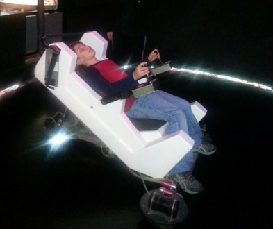 Trying out the Jet Pack Simulator at The Tech Museum of Innovation. Photo credit: Gwen Kleist, Healthy TravelingMom.