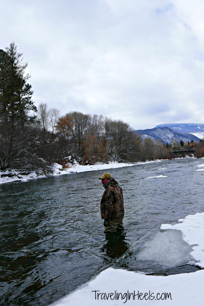 Wiith insulated waders, you can also wade in to fly fish in the winter...and yes, although you're dry, it's cold! Photo: Diana Rowe / Traveling Grandmom