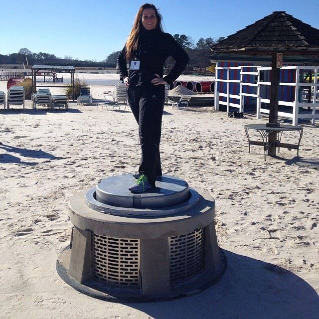 Family Fun Traveling Mom Desiree Miller posing on the stand used in the Hunger Games movie during the scenes shot in the Cornucopia (filmed near Atlanta, GA). Photo courtesy of Desiree Miller