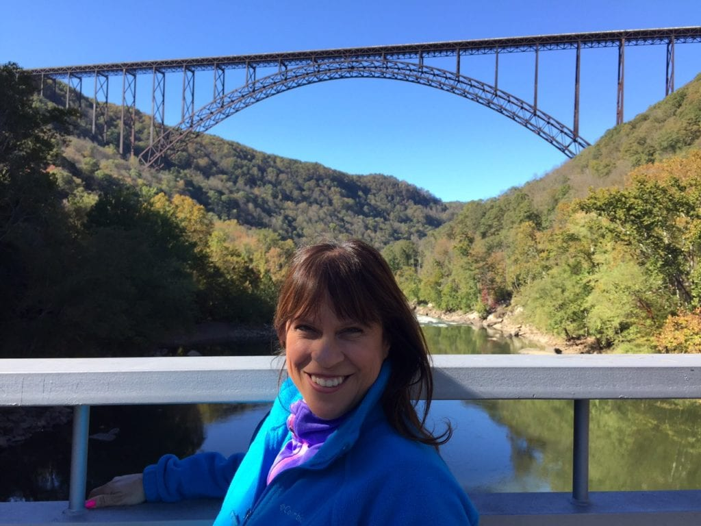 Adventure TravelingMom Fran Capo poses in front of the New River Gorge Bridge before her big adventure. Photo courtesy of Fran Capo