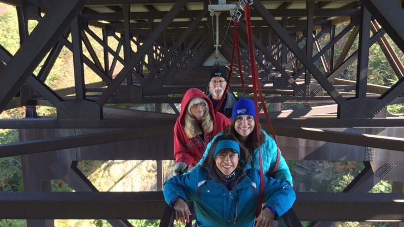 Daredevil walkers pose on the New River Gorge Bridge. Photo courtesy of Fran Capo/ Adventure TravelingMom
