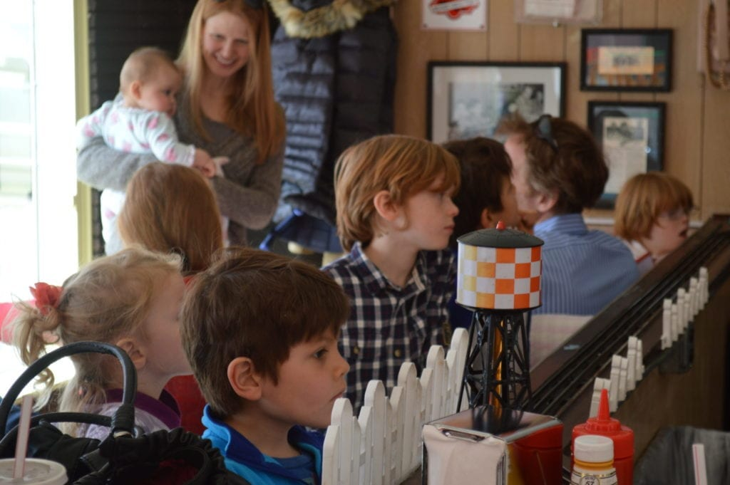 Some young patrons waiting patiently for their food delivery at the Choo Choo diner. Photo credit: Alexandra Olsen