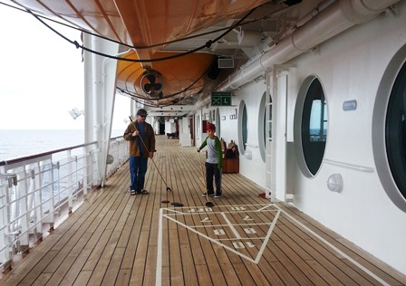 Shuffleboard is one of many Disney themed and classic cruise activities available. Photo credit: Gwen Kleist, Healthy TravelingMom.