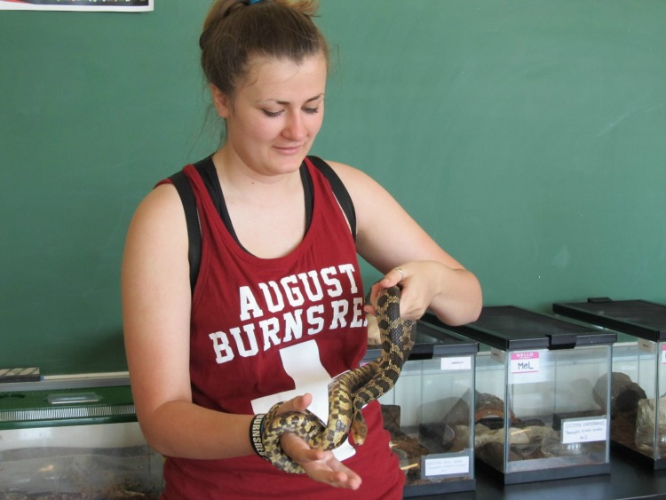 Holding water snakes while visiting Put-in-Bay and Kelleys Island on Lake Erie