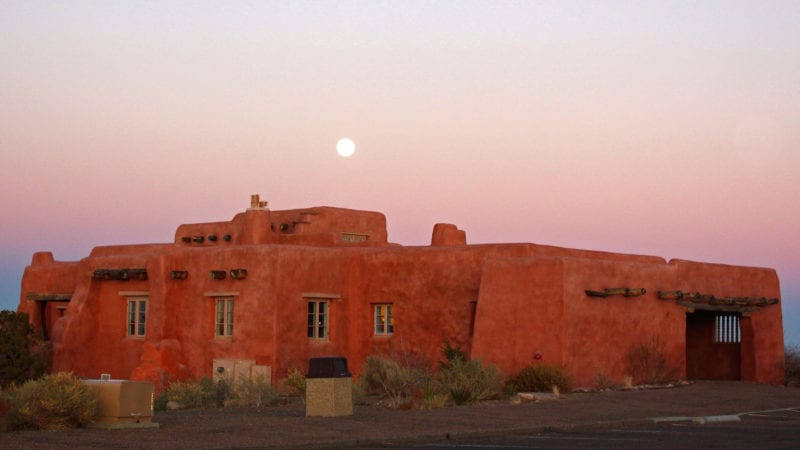 Originally built in the 1920s, the Civilian Conservation Corps added the thick stucco wall. Painted Desert Inn, Petrified Forest, national park, Arizona
