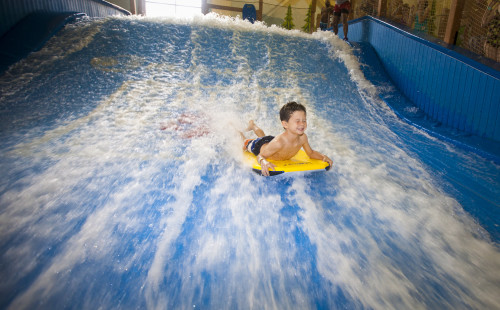 Surfing the Wolf Rider Wipeout. Photo credit: Great Wolf Lodge.