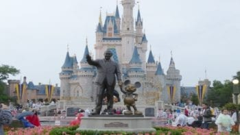 walt and mickey statue in front of Cinderella Castle at Walt Disney world's magic kingdom