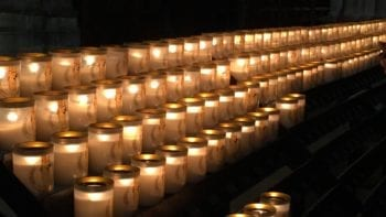 Candles at Notre Dame Cathedral in Paris. Photo by Desiree Miller / Family Fun TravelingMom