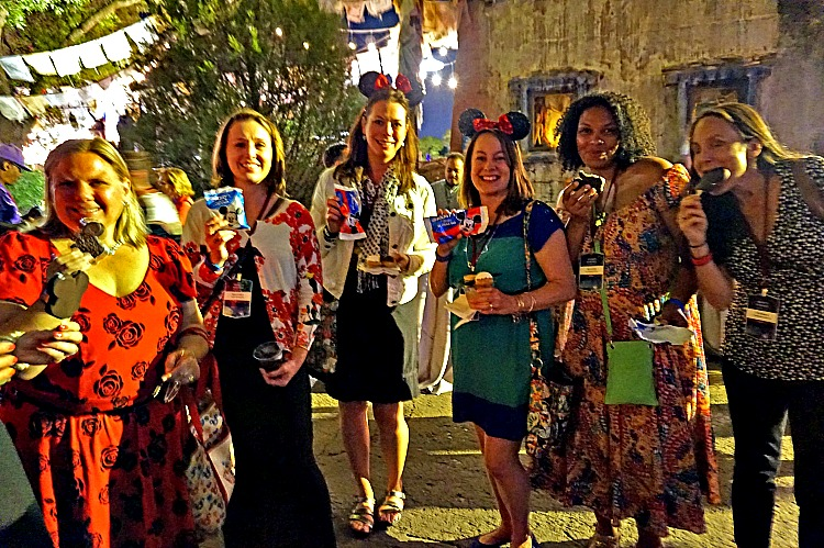 Disney girlfriend getaway. Girls cooling down with Mickey ice cream and enjoying Disney After Dark at Animal Kingdom.