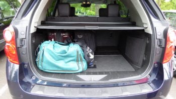 road trip hacks pack less trunk of car with luggage on the left hand side