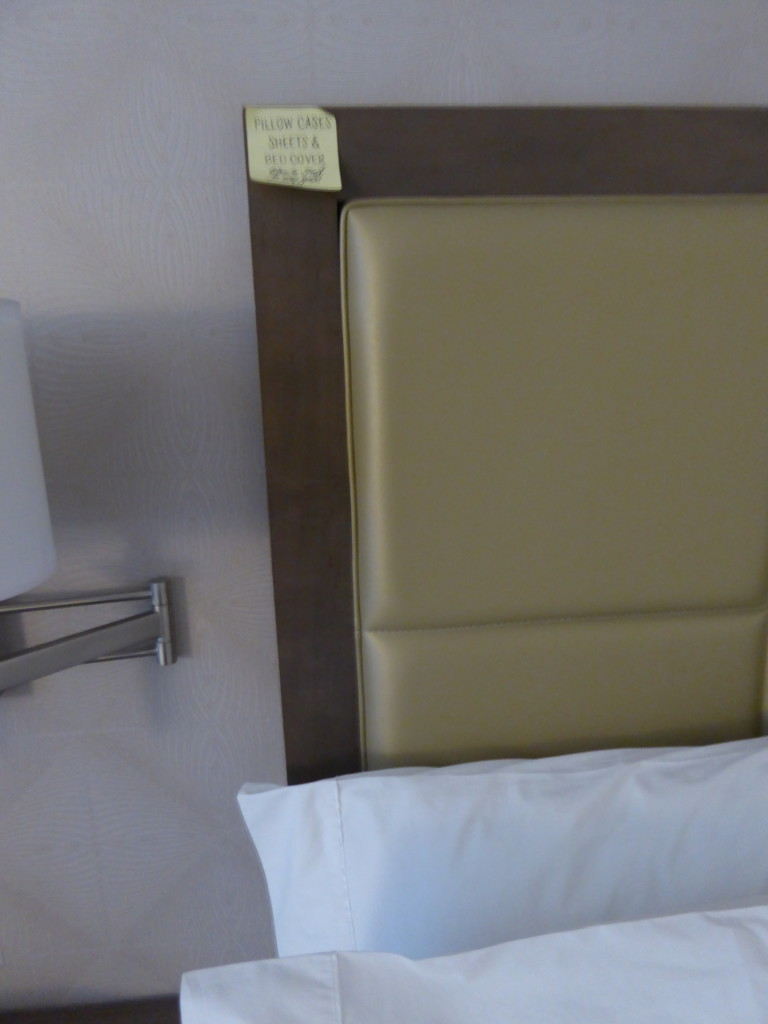 The post-it note assures guests at the Hampton Inn Chicago that the comforter have been freshly laundered, a nice touch.