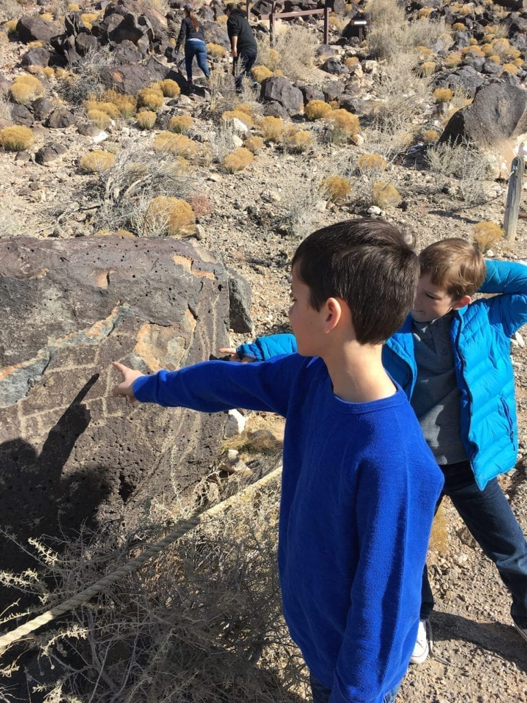 My boys challenge each other to a petroglyph I spy game. Petroglyph National Monument