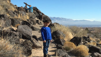 Keeping the kids happy on a road trip can be hard, a quick hike can help. Petroglyph National Monument