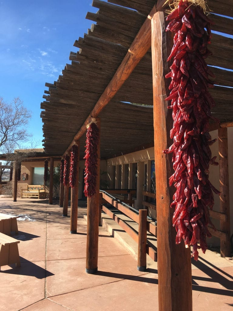 Start at the Petroglyph National Monument's Visitor Center. I find maps along with New Mexico's red chilis.