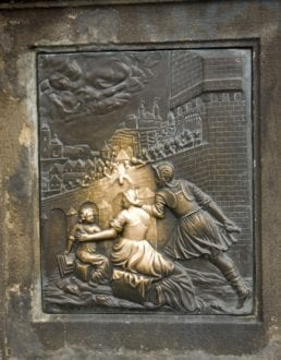Plaque on Statue of St John Nepomuk on Charles Bridge Prague