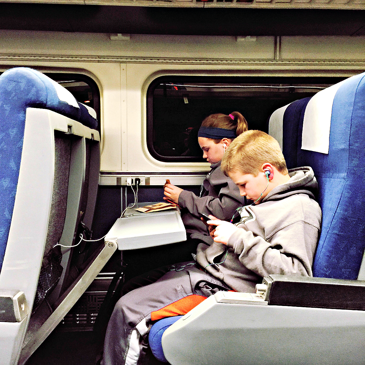 Electronics welcome on Amtrak with plug and play stations. Photo: Becky Davenport, Budget Traveling Mom