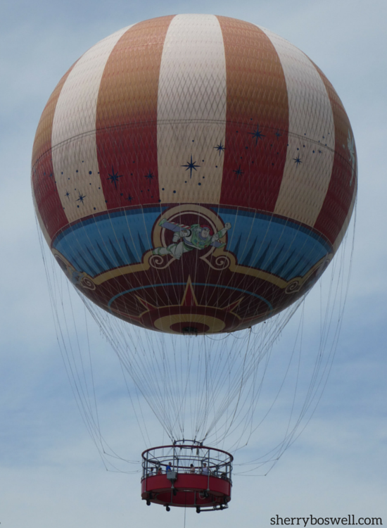 Characters in Flight hot air balloon sails high over Disney Springs. Photo by Sherry Boswell, Melodious TMOM.