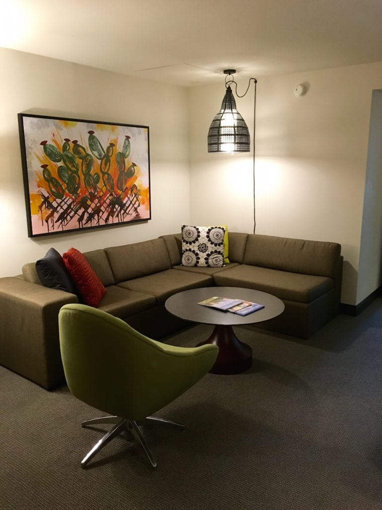 The front room in our suite at Hotel Contessa features a sectional, a work desk with a charging station and a separate TV. Hotel Review Hotel Contessa, hotels on the River Walk,