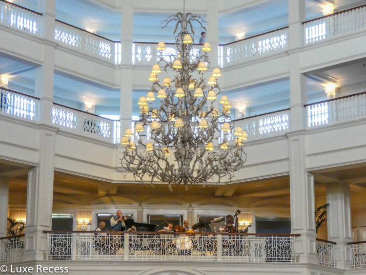 The Grand Floridian Orchestra fills the five-story lobby with incredible energy from the second floor balcony.