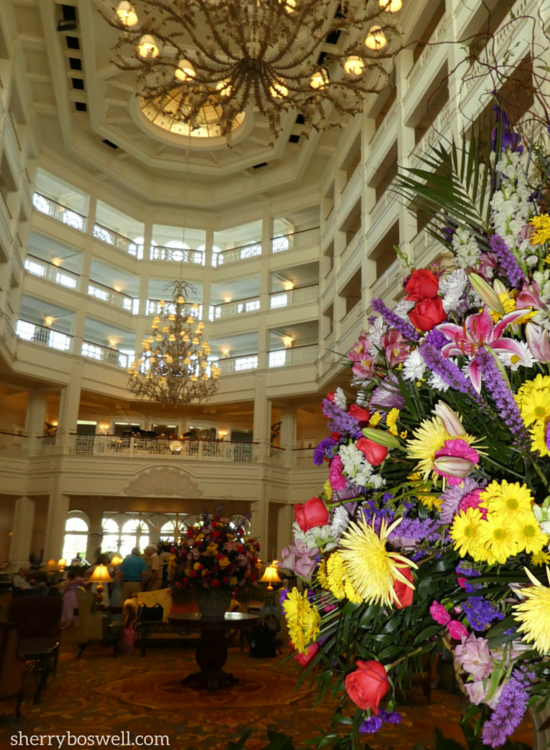 The Grand Floridian lobby view is floral, open, and multistoried.