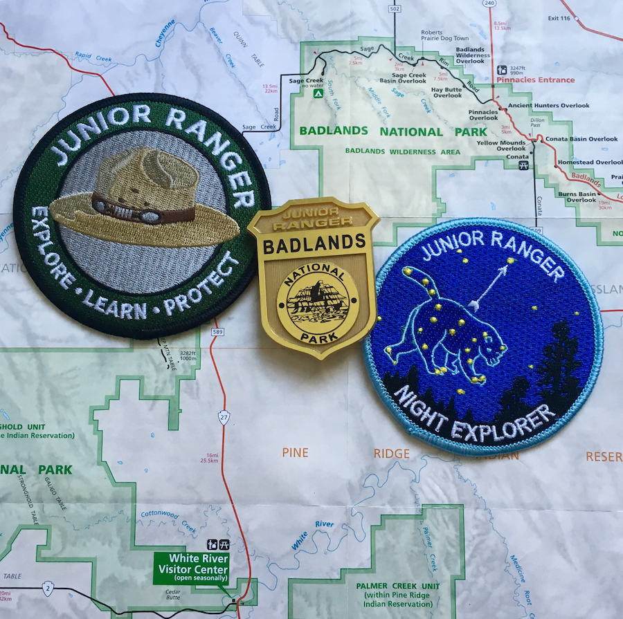 Badlands National Park offers several Junior Ranger badges like the Night Explorer patch and the Junior Paleontologist.