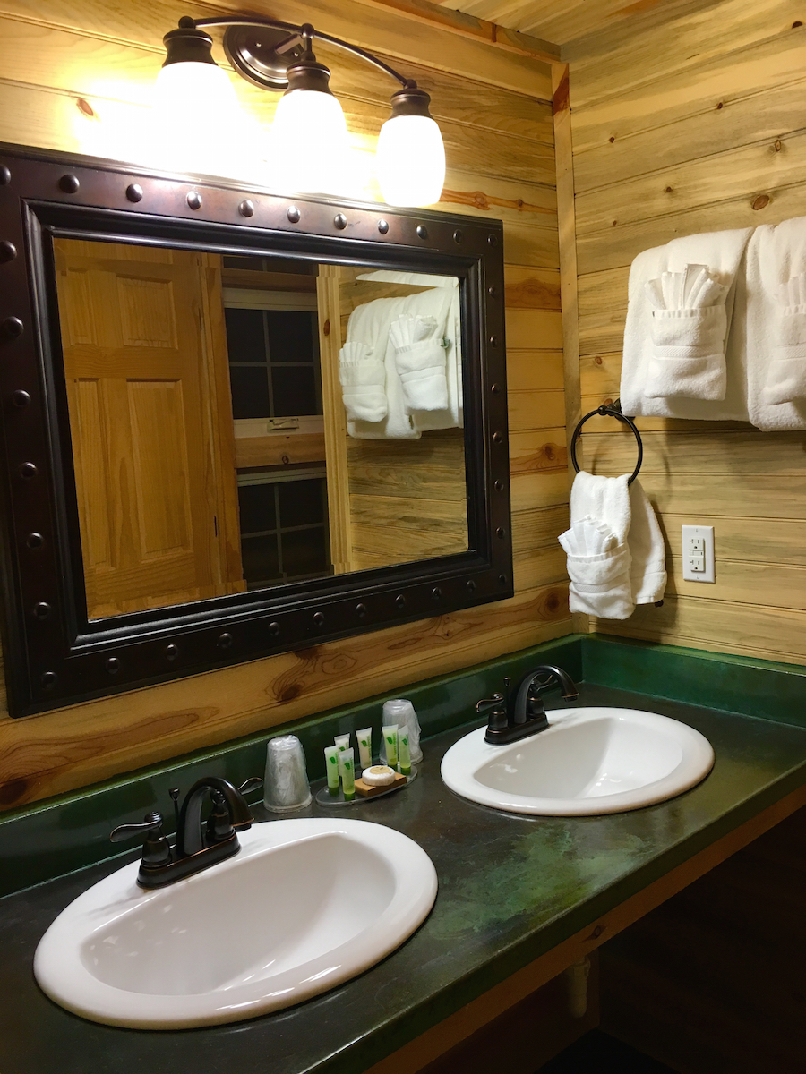 The bathrooms at Cedar Pass Lodge have stained concrete counters with a double vanity along with a shower.