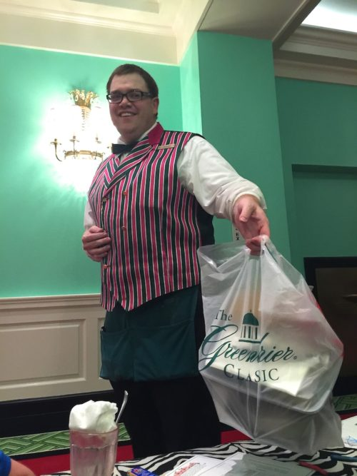 A Greenbrier waiter delivers dinner to guests sitting on the floor of the only hallway with power (Photo Philadelphia TMOM Sarah Ricks)