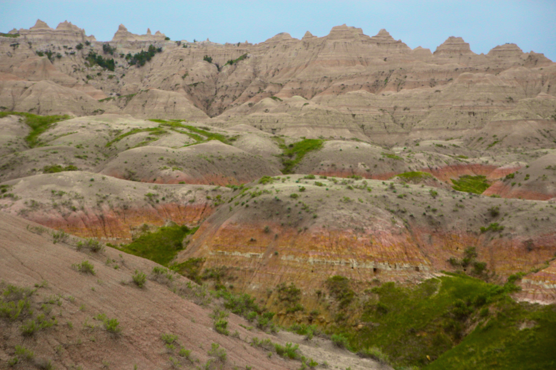 Positioned where the plains meet the mountains of South Dakota's Black Hills, Badlands National Park is stunning especially in the soft light of dawn or dust