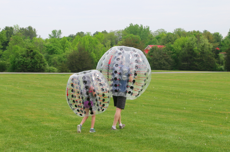 Daughter chasing daddy in knockerball. Photo by: Jenn Mitchell, Fitness TMOM