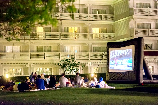 Group watching a movie outside Free Things Disney World