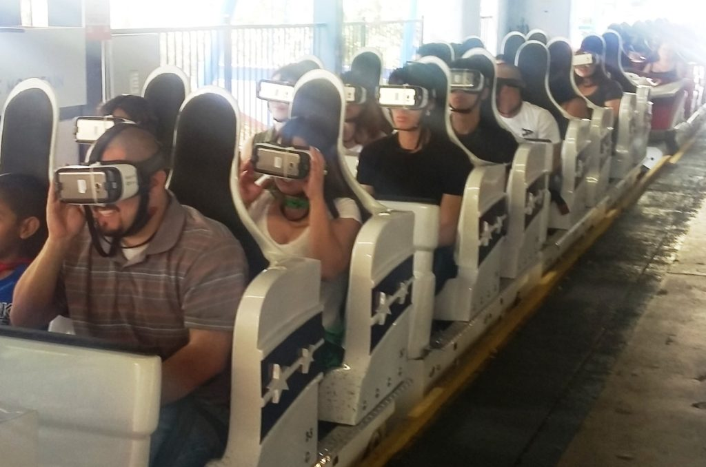 Riders wear virtual reality headsets to experience The New Revolution. Photo credit: Gwen Kleist, Healthy TravelingMom.