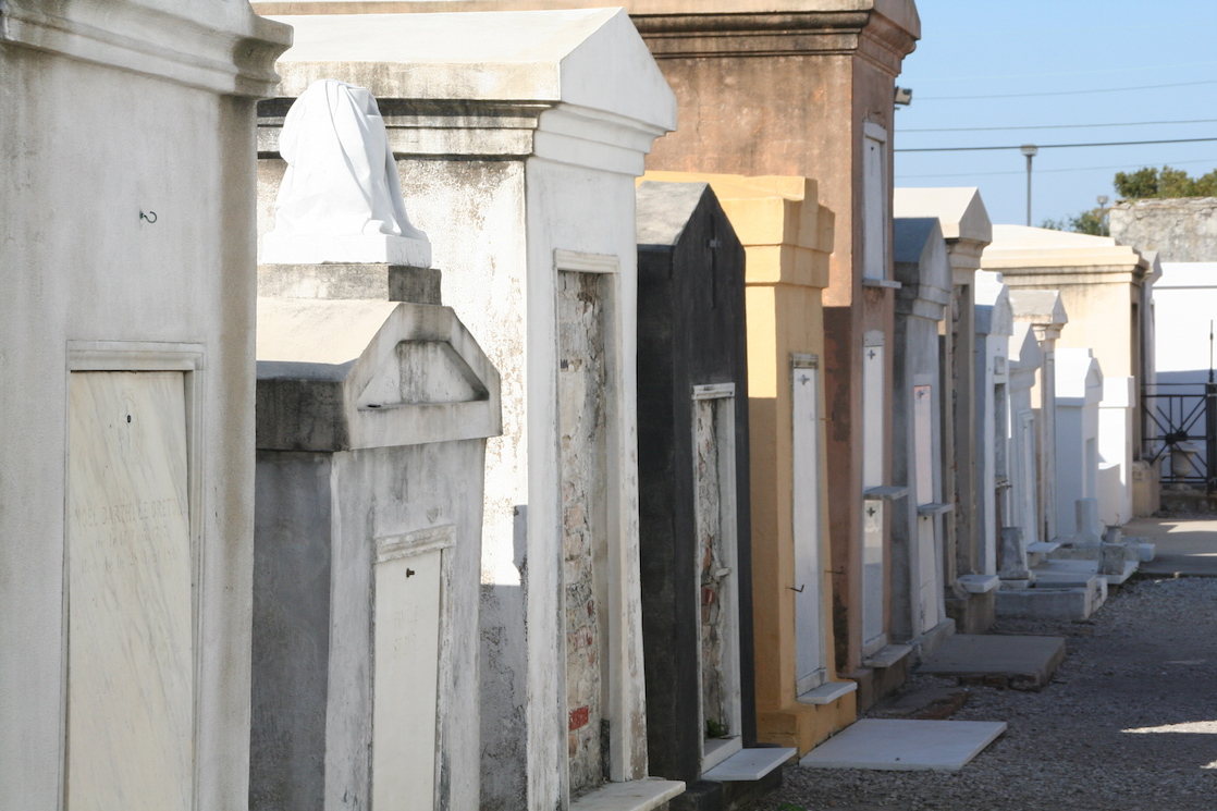 Fun free things to do in New Orleans with kids--peek in at a cemetery. If you want to go inside, you will need to pay a fee.