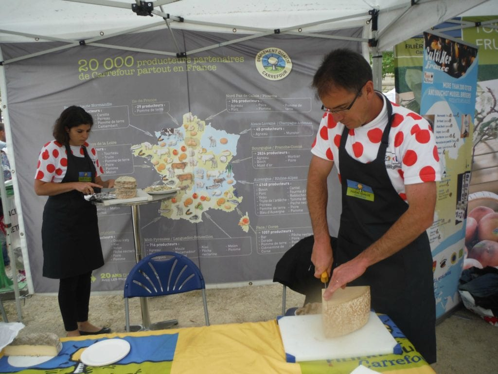 Taste French food for free at some of the booths that line the Tour de France route in Paris.