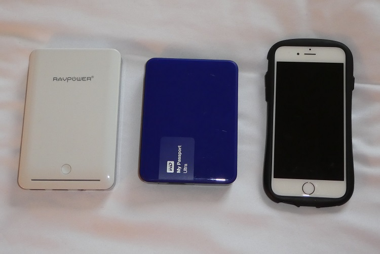 WD My Passport Ultra drive is comparable in size to a RAVPower portable charger or an iPhone 6.