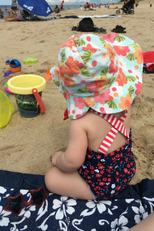 Baby with sunglasses at the beach