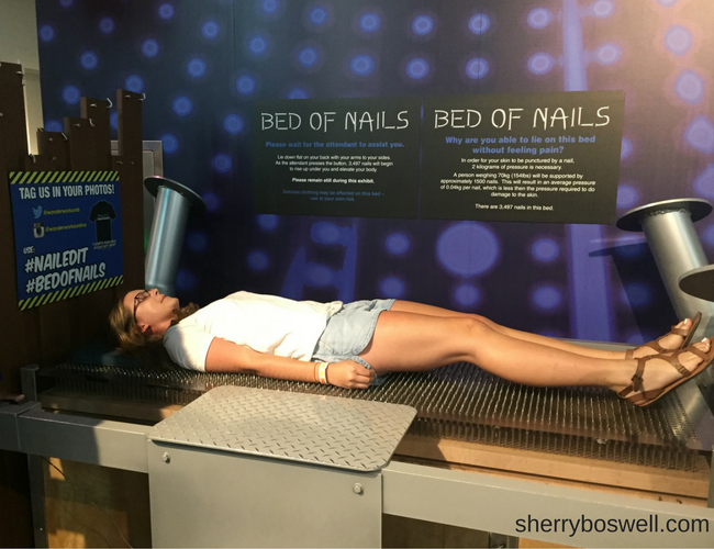My teen was fearless as she tried the Bed of Nails at WonderWorks in Myrtle Beach. Photo by Sherry Boswell, Melodious TravelingMom.