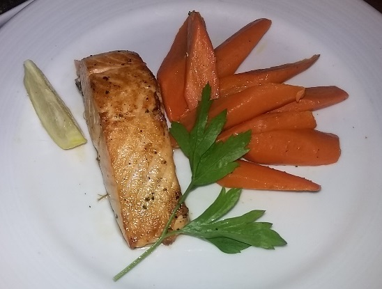 A fabulous and healthy salmon dinner aboard the Carnival Inspiration. Photo credit: Gwen Kleist, Healthy TravelingMom.