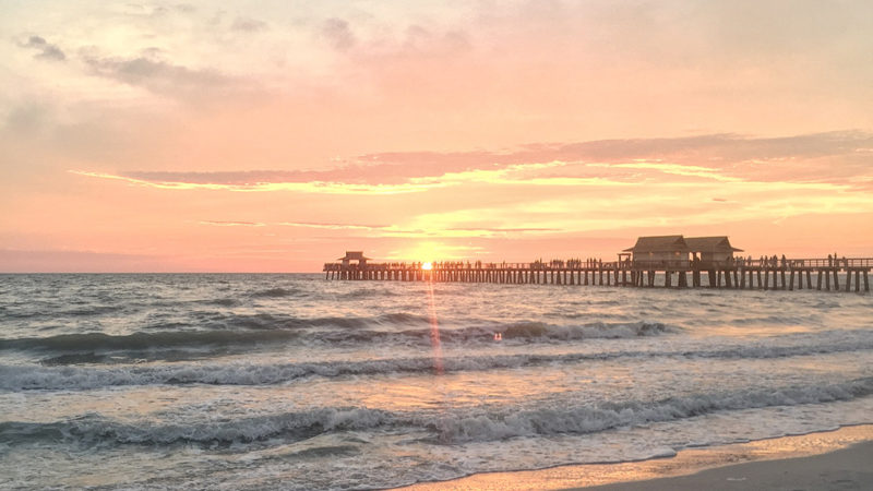 The sunset behind the Naples pier is a perfect reason to get a babysitter and do a date night when visiting.